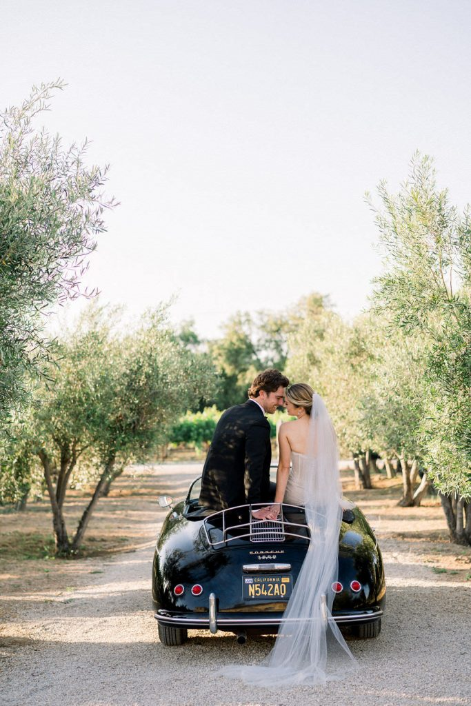Fine Art Photograph of a Prewedding shot of Bride and Groom in a classic car at Sunstone Winery by Peopny Park Photography