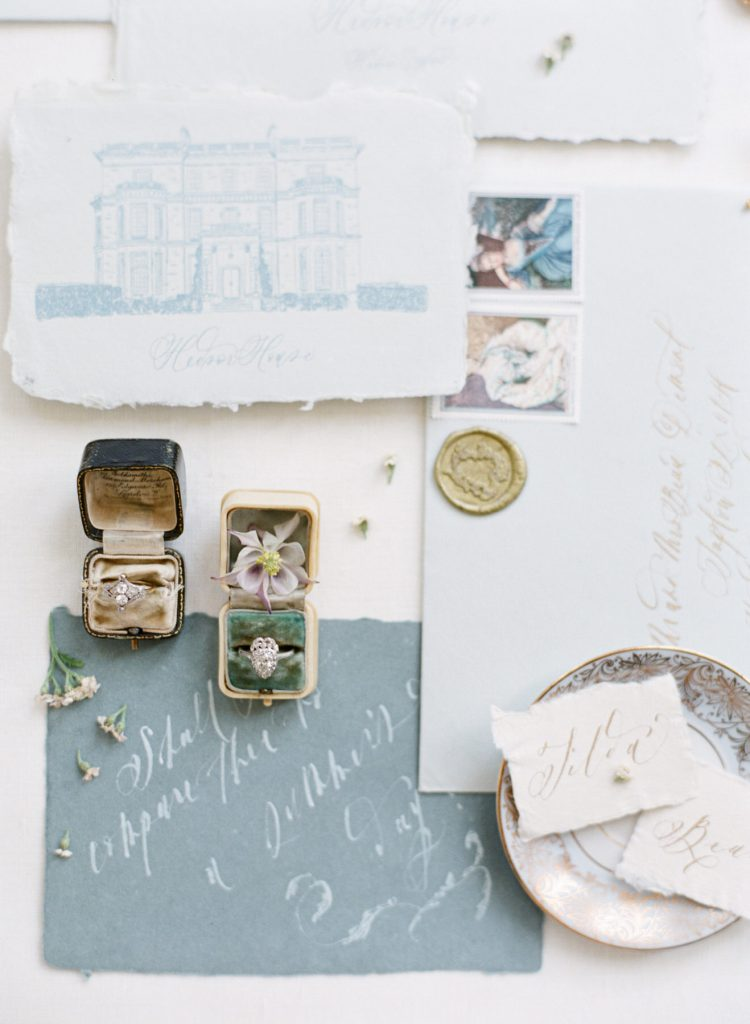 fine art wedding stationery with gold wax seal, handmade cotton paper, calligraphy and vintage stamps under vintage ring boxes photographed by Catherine of Peony Park Photography at Hedsor House
